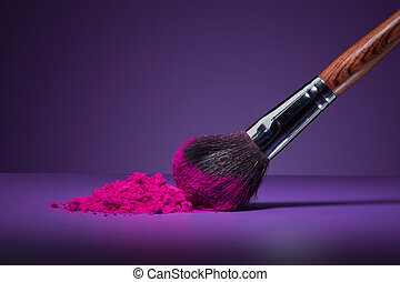 Brush and face powder - Clouse-up of makeup brush and face...