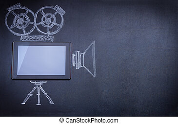 Tablet computer as movie camera on the blackboard with...