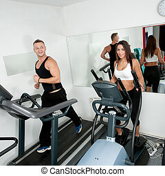 Young people working out in fitness center