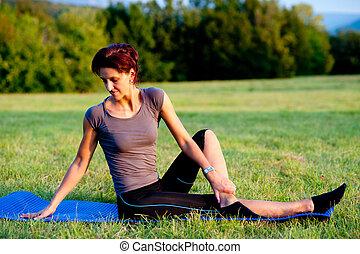 Woman practice yoga outdoor in park