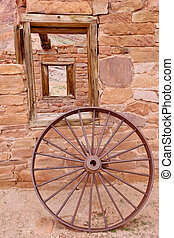 Historical Lees Ferry, AZ - A wheel in front of historic...