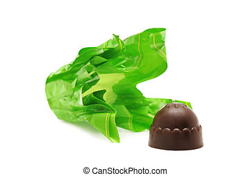Chocolates and candy wrapper isolated on a white background...