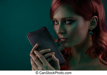Beauty portrait with purse