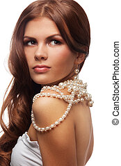 Yung woman with pearls necklace - Portrait of young woman...