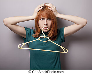 Surprised girl with hanger
