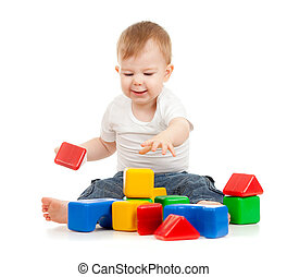 little funny child playing with building blocks