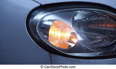 Car indicator head light - Car indicator light in a rainy...