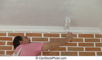 House Painter using paint roller
