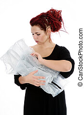 Imaginary pregnancy - Girl with red hair holds in her hands...