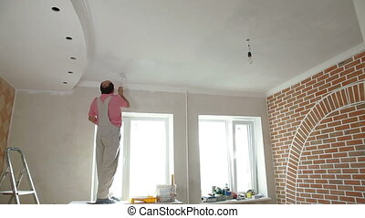 House Painter painting the kitchen - House Painter painting...