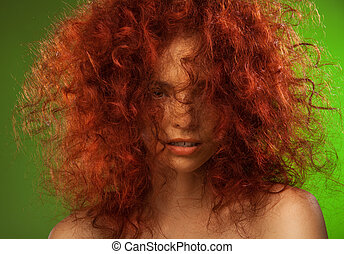 Red curly hair woman beauty portrait with her face partly...