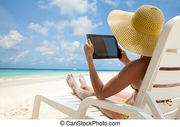 Tablet computer - nice to have thing on vacation - Woman...