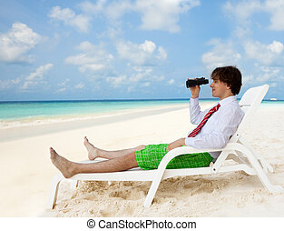 Looking for good vacation options - Businessman sitting on...