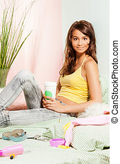 teenage girl in bed with fast-food coffee