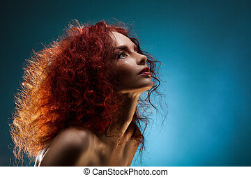 Portrait of a curly red hair woman