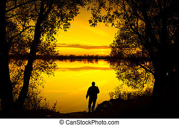 Silhouette at sunset - Silhouette of a man at sunset