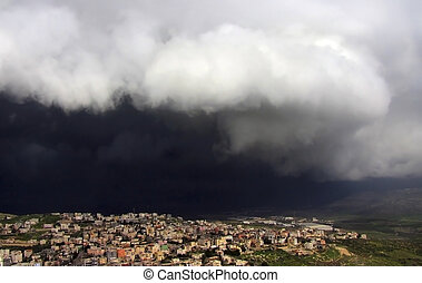 Cana of Galilee before the storm - black storm cloud hanging...