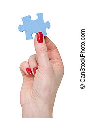 hand with a piece of blue puzzle