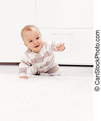 Baby girl learns to crawl - Happy smiling baby girl learns...