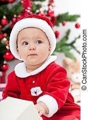 Baby girl and christmas tree - closeup