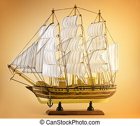 sailing ship on yellow - sailing ship toy isolated on yellow...