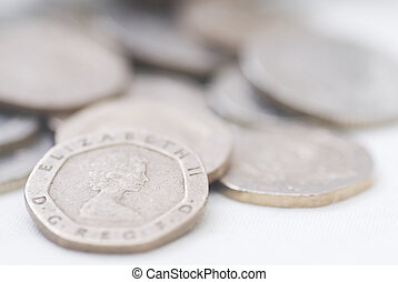 Spilled coins, focus on 20 pence coin Sterling