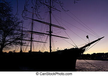 Sailing vessel - Silhouette of sailing vessel  in night sky.