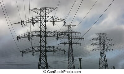 Electricity - Electrical pylons with timelapse clouds Clean...