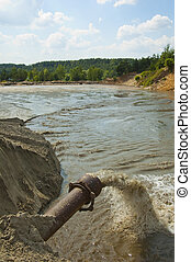Dirty water flows from a pipe. Toxic production wastes