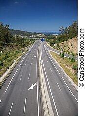 highway to Vigo city - three lanes highway next Vigo city in...