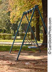 Swing set - Empty swing set in a park, nobody