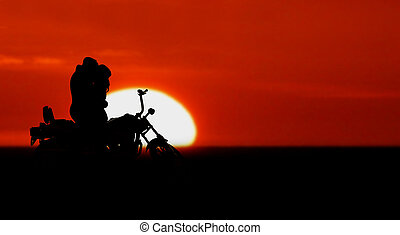 Motorcycle - Couple kissing near their motorcycle at sunset