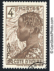 Baoule Woman - IVORY COAST CIRCA 1936: stamp printed by...