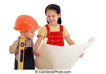 Two smiling little builders planning with liquid level and...