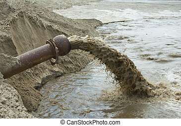 Dirty water flows from a pipe Toxic production wastes