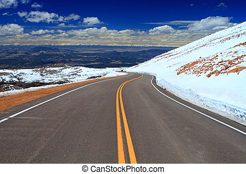 Road in the mountains - Road through Pikes Peak mountain of...