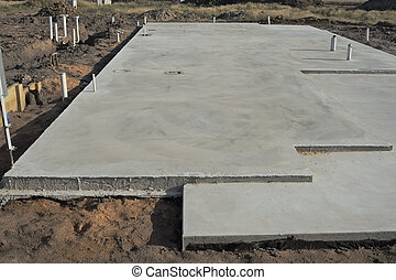 Concrete slab prepared for residential house construction...