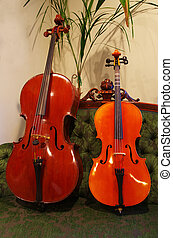 large and small Cello - a full size cello and small cello...