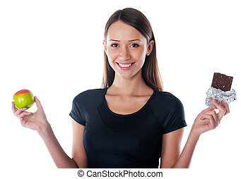 pleased  girl with chocolate and apple in the hands