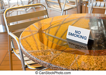 no smoking table in outdoor cafe
