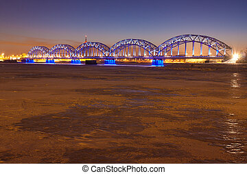 Railway bridge at night in winter