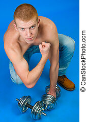man with free weights isolated on blue