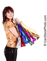 Beautiful happy woman with shopping bags