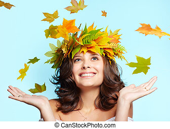 young woman and leaf fall - portrait of beautiful happy...