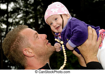 Happy baby and father