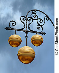 Pawnbroker Shop - Pawnbroker shop sign with three golden...