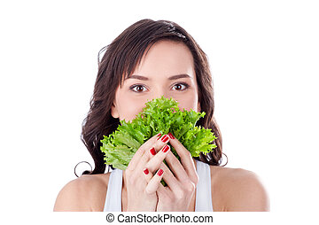 Young girl eating fresh salad - Young girl holding letucce...