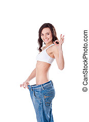 slim woman in big jeans showing thumbs up