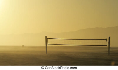 Deserted Beach Volleyball - A deserted volleyball net on a...