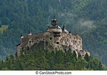Hohenwerfen castle in Austria on Alps backgrond